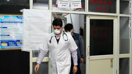Doctors are seen in front of an insloation ward for coronavirus patients in Amritsar, Punjab, on March 7, 2020.