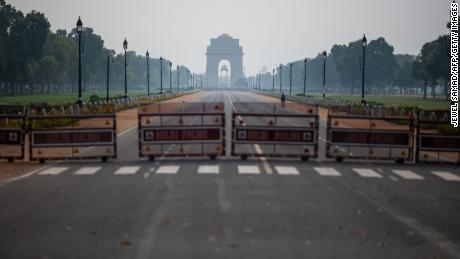 A man walks on a deserted path leading to India Gate during a government-imposed lockdown in New Delhi on March 24, 2020.
