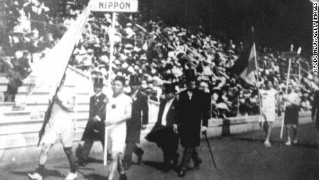 The Japanese athletic delegation marches during the opening ceremony of the 1912 Olympic Games in Stockholm, Sweden, which marked Japan's first Olympic appearance. The sign holder was marathon runner Shiso Kanaguri (R front) and the flag bearer was sprinter Yahiko Mishima (L front). (Photo by Kyodo News Stills via Getty Images)
