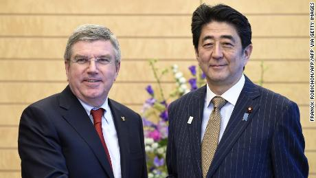 International Olympic Committee (IOC) President Thomas Bach (L) and Japanese Prime Minister Shinzo Abe shake hands prior to their meeting at Abe's official residence in Tokyo on March 13, 2015.