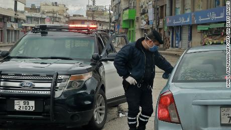 A policeman speaks to a driver at a checkpoint in Amman on Saturday.