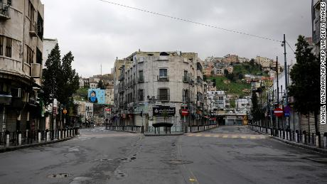 A usually busy street in the Jordanian capital Amman lies deserted.
