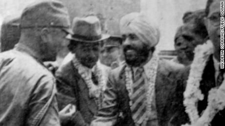 Japanese Major Fujiwara Iwaichi greets Captain Mohan Singh of the Indian National Army.