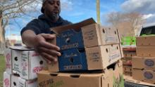 Chef Maxcel Hardy moves boxes of perishable foods donated to the initiative.