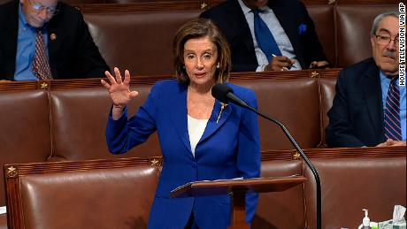 In this image from video, House Speaker Nancy Pelosi addresses the House of Representatives after wiping down the microphone.