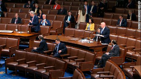 House members sit spaced apart as Rep. Kevin McCarthy, left, speaks, in an image taken from video.