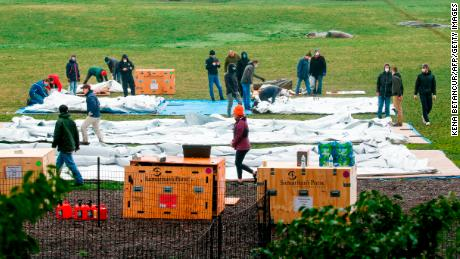Workers set up a field hospital in Central Park on March 29, 2020 in New York City.