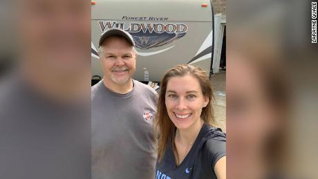 Tim Webb drove 2.5 hours to temporarily donate his travel trailer to LaRayne Quale (right).