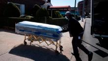 William Samuels delivers caskets to the Gerard Neufeld Funeral Home in the Queens borough of New York City on Friday, March 27, 2020.