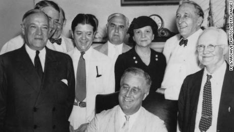 Frances Perkins stands behind President Franklin D. Roosevelt as he signs the Social Security Act into law in August 1935. (FPG/Archive Photos/Getty Images)