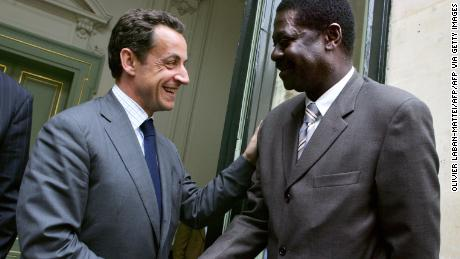 Diouf shakes hands with the then French Interior Minister Nicolas Sarkozy.