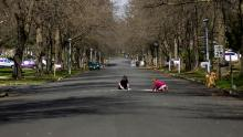 Children play on a residential street in Matawan, New Jersey on April 1, 2020.