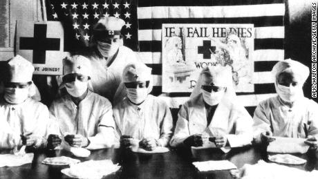 In the 1918 flu pandemic, not wearing a mask was illegal in some parts of America. What changed?