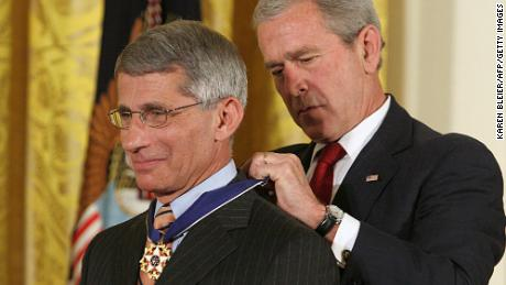 US President George W. Bush presents the Presidential Medal of Freedom to Dr. Anthony Fauci in 2008.