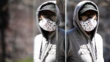 A person wearing protective masks due to coronavirus concerns walks in Philadelphia, Thursday, April 2, 2020. (AP Photo/Matt Rourke)