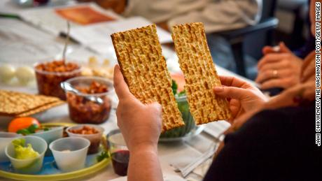 ROCKVILLE, MD - APRIL 24: Rabbi Janet Ozur Bass breaks a piece of unleavened bread at an Interfaith Passover seder hosted by Montgomery County council member Sidney Katz at the Montgomery County Council Office Building on Wednesday, April 24, 2019, in Rockville, MD.  About 20 religious leaders of different faiths gather in an effort to combat a spate of hate crimes in Montgomery County.  Three-fourths of the the 37 reported bias crimes motivated by religion last year were anti-Semitic, according to Montgomery police. (Photo by Jahi Chikwendiu/The Washington Post via Getty Images)