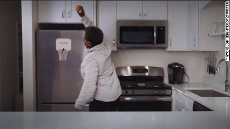 Chicago Mayor Lori Lightfoot takes it to the hoop in her kitchen.