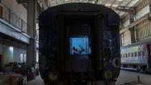 An Indian railway employee works to convert a train coach into an isolation ward for the fight against the new coronavirus in Gauhati, India, Sunday, March 29, 2020.