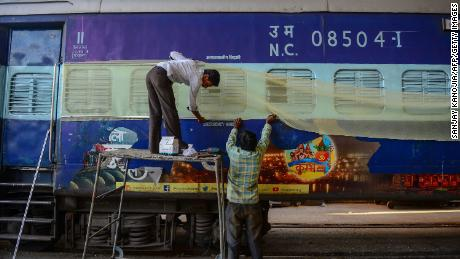 Labourers work on train coaches that will be used as temporary isolation wards in preparation for coronavirus-infected patients during a government-imposed nationwide lockdown as a preventive measure against the Covid-19 coronavirus, at a workshop in Allahabad on April 4, 2020.