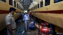 Workers wearing facemasks carry on works on train coaches that will be used as temporary isolation wards in preparation for Covid-19 coronavirus patients, at a coach factory workshop in Chennai on March 30, 2020.
