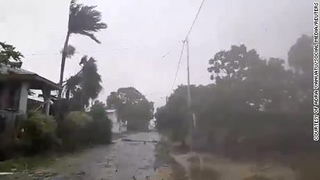 The storm blows through Luganville, Vanuatu on Monday.