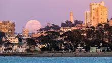 A full moon rises above the horizon in San Francisco, California on April 7, 2020.