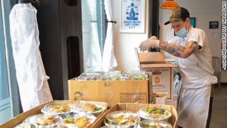 Golden Diner, one of Off Their Plate's restaurant partners in New York, prepares meals for Elmhurst Hospital.
