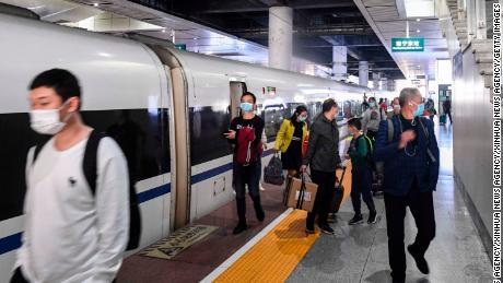 Passengers alight from the first train out of Wuhan in Nanning city, in China's Guangxi region, on Wednesday.