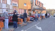 People wait in line to enter a reopened shop in the city of Havirov, in the Czech Republic, on Thursday.
