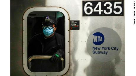 An MTA worker wears a surgical mask at the Grand Army Plaza station in Brooklyn.