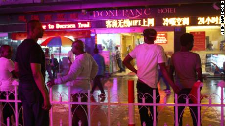 Africans stand in front of the Don Franc hotel in Guangzhou, before the coronavirus crisis.