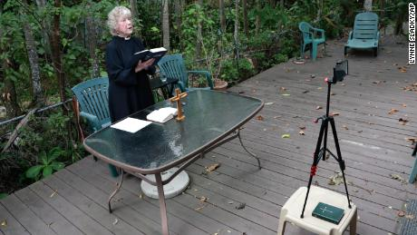 Rev. Jo-Ann Murphy, assistant rector of St. Stephen's Episcopal Church, live streams a Good Friday Mass from her backyard during the new coronavirus pandemic.