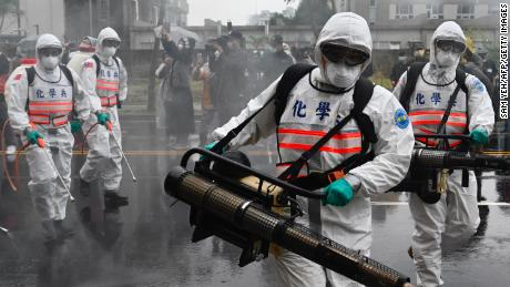 Soldiers from the military's chemical units take part in a drill to help slow the coronavirus' spread in the Xindian district near Taipei on March 14