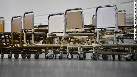 Newly installed hospital beds for coronavirus patients at the Hannover Messe trade fair grounds in Germany on April 4. The facility has 500 beds for patients who do not need intensive care.