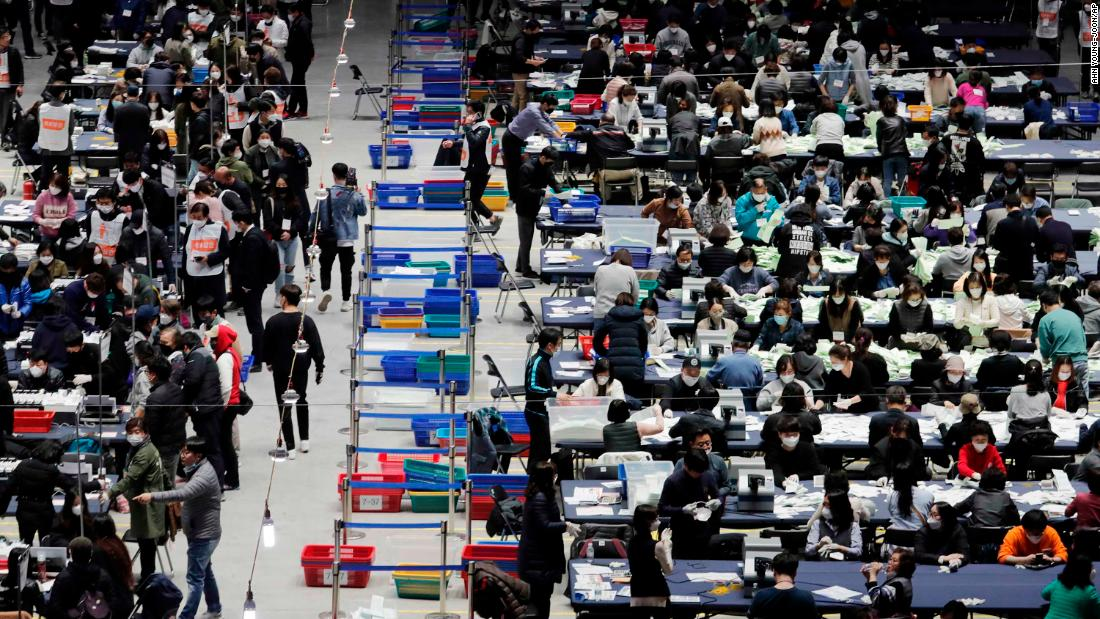 "South Korean election officials sort out <a href =""https://edition.cnn.com/2020/04/15/asia/south-korea-election-intl-hnk/index.html"" target =""_blank&ampquott;>parliamentary ballots </un>at a gymnasium in Seoul on April 15."