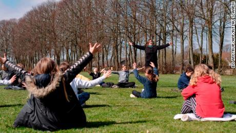 Teacher Rebekka Hjorth has a music lesson with her class outdoors at the Korshoejskolen public school in Randers, Denmark, on April 15.