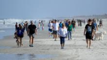 Beachgoers in Jacksonville, Florida, came out in droves to enjoy the recently reopened beach on April 17. Activities are limited to walking, running, biking and fishing.