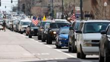 Vehicles stack up in Denver during an April 19  protest against the state's stay-at-home order.