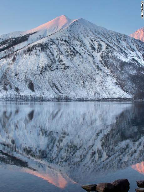 Stanton mountain on Lake McDonald reflections in Glacier National Park, Montana, USA