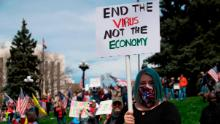 """Demonstrators gather at the Colorado state Capitol to protest coronavirus stay-at-home orders during a """"ReOpen Colorado"""" rally in Denver on April 19."""