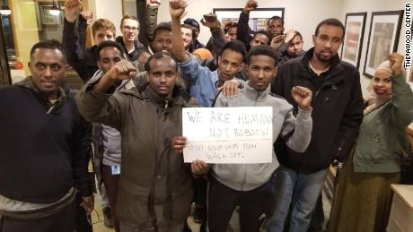 """Employees from Amazon's Shakopee facility gather after worker action in March 2019. """"We don't want them to treat us as robots,"""" Mohamed told CNN Business."""