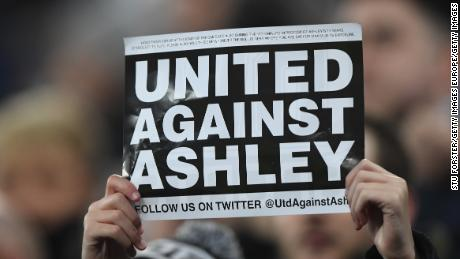 A fan protests against Mike Ashley during Newcastle's game against  Man City last season.