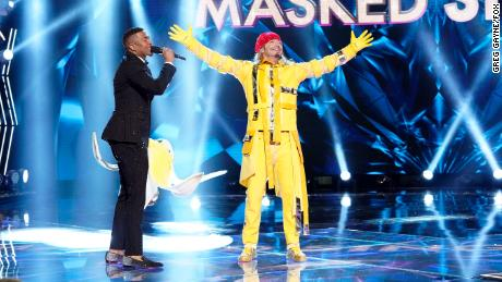 """Host Nick Cannon reveals Bret Michaels on Wednesday as the person in the banana costume on """"The Masked Singer."""""""