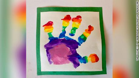 Prince Louis painted his own rainbow picture, using a hand print.