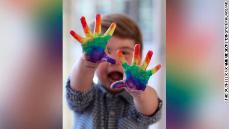 Prince Louis painted a rainbow in photos released to mark his second birthday.