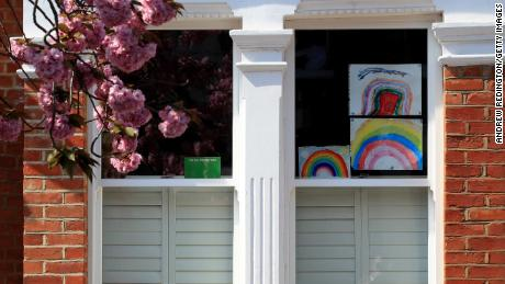 Homemade drawings of a rainbow are pictured in a window on April 9 in London, England.