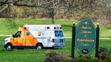 An ambulance departs Andover Subacute and Rehabilitation Center in Andover, New Jersey. (Eduardo Munoz Alvarez/Getty Images)