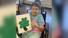 Fryz's mother Loretta posed with a shamrock last month.