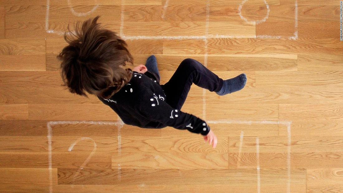 A boy plays hopscotch at his home in A Coruna, Spagna, in aprile 23.