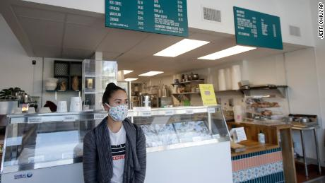 Rica Sunga-Kwan, owner of Churn Urban Creamery, wears a mask while interviewed at her shop in San Francisco on Thursday, April 23.